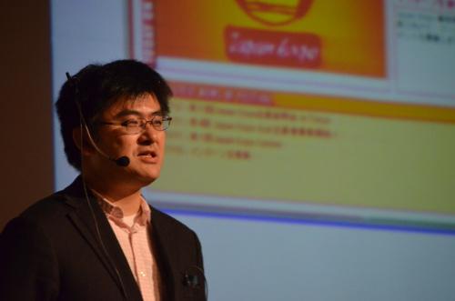 「コンテンツの全体像」と題し,市場やビジネスモデル,日本のアニメ文化などについて語る小山氏