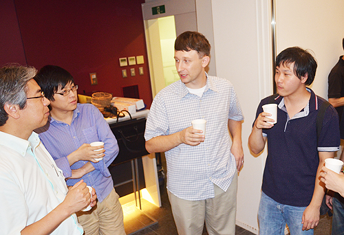 "Welcome Coffee Hour"" – Professor Val Kolesnikov (center) talked with faculties and students"